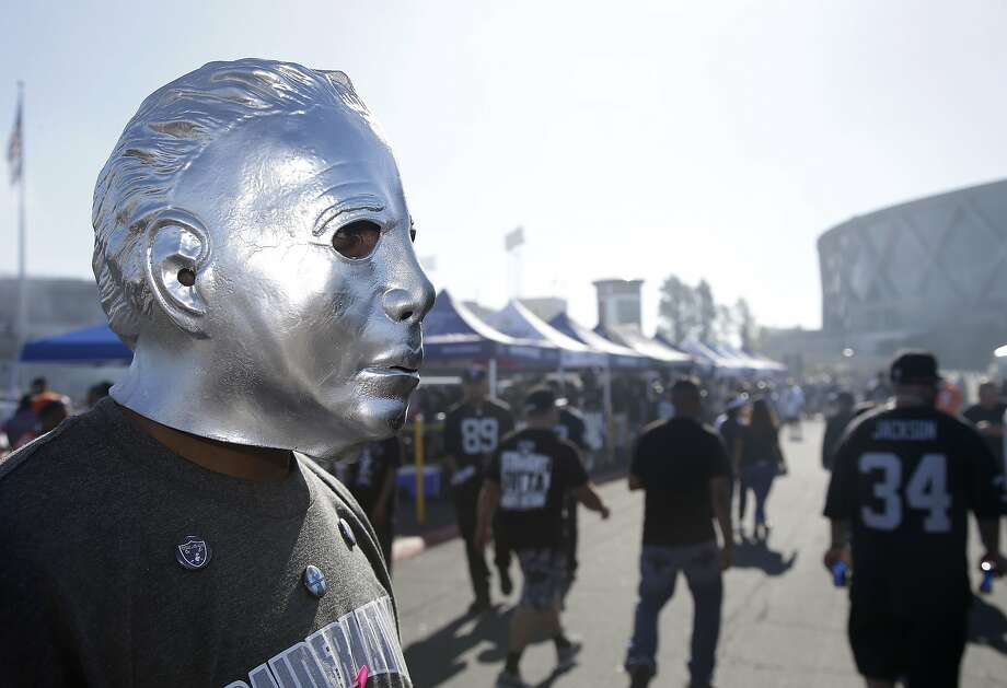 "Oakland Raiders fans tailgate outside the Coliseum before a game with the Denver Broncos in this 2015 file photo. At the Sept. 9, 2019, ""Monday Night Football"" game, ICE agents raided tailgate parties at the Coliseum and seized $11,000 worth of illegal team gear. (AP Photo/Marcio Jose Sanchez) Photo: Marcio Jose Sanchez, Associated Press"