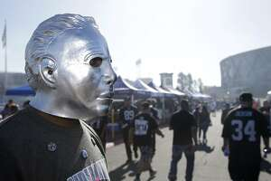 Oakland Raiders fans tailgate before an NFL football game between the Raiders and the Denver Broncos in Oakland, Calif., Sunday, Oct. 11, 2015. (AP Photo/Marcio Jose Sanchez)