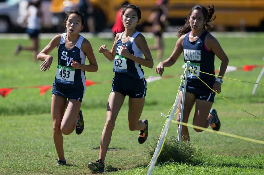 Smithson Valley runners Kylie (left) and Kerri Welch (center) compete in the Class 6A girls Region IV cross country championships at Texas A&M-Corpus Christi on Oct. 26, 2015. Photo: Courtney Sacco /Corpus Christi Caller-Times / Courtney Sacco