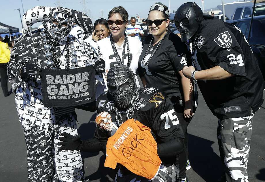 Oakland Raiders fans tailgate before an NFL football game between the Raiders and the Denver Broncos in Oakland, Calif., Sunday, Oct. 11, 2015. (AP Photo/Jeff Chiu) Photo: Jeff Chiu, Associated Press