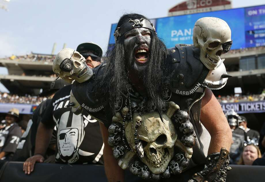 In this Sept. 13, 2015, file photo, Oakland Raiders fans watch during the second half of an NFL football game between the Oakland Raiders and the Cincinnati Bengals in Oakland, Calif. The south end zone sections of Oakland-Alameda County Coliseum are known to have some of the rowdiest fans in American sports, face painters who dress up in evil costumes, often with spike-covered shoulder pads. (AP Photo/Tony Avelar, File) Photo: Tony Avelar, Associated Press