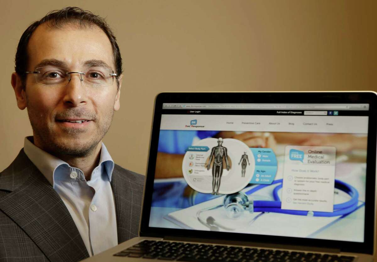 Dr. Tarek Fahl, founder and CEO of DocResponse, poses with view of his online symptom checker shown in his office Friday, Oct. 23, 2015, in Tomball. ( Melissa Phillip / Houston Chronicle )