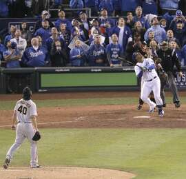 Giants Madison Bumgarner and Royals Salvador Perez watch his game-ending pop up during Game 7 of the World Series at Kauffman Stadium on Wednesday, Oct. 29, 2014 in Kansas City, Mo.