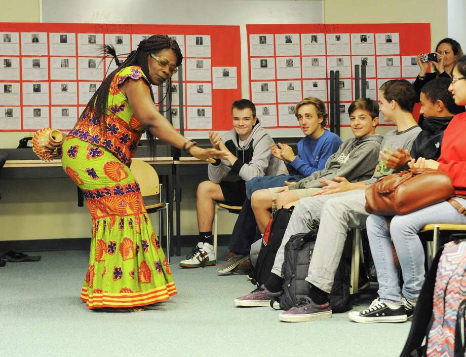 Princess Omaa Adaobi Ume-Ezeoke, a storyteller and teacher from Nigeria, sings and dances during a Greenwich Reads Together presentation Monday in the Greenwich High School media center. Photo: Tyler Sizemore / Hearst Connecticut Media / Greenwich Time