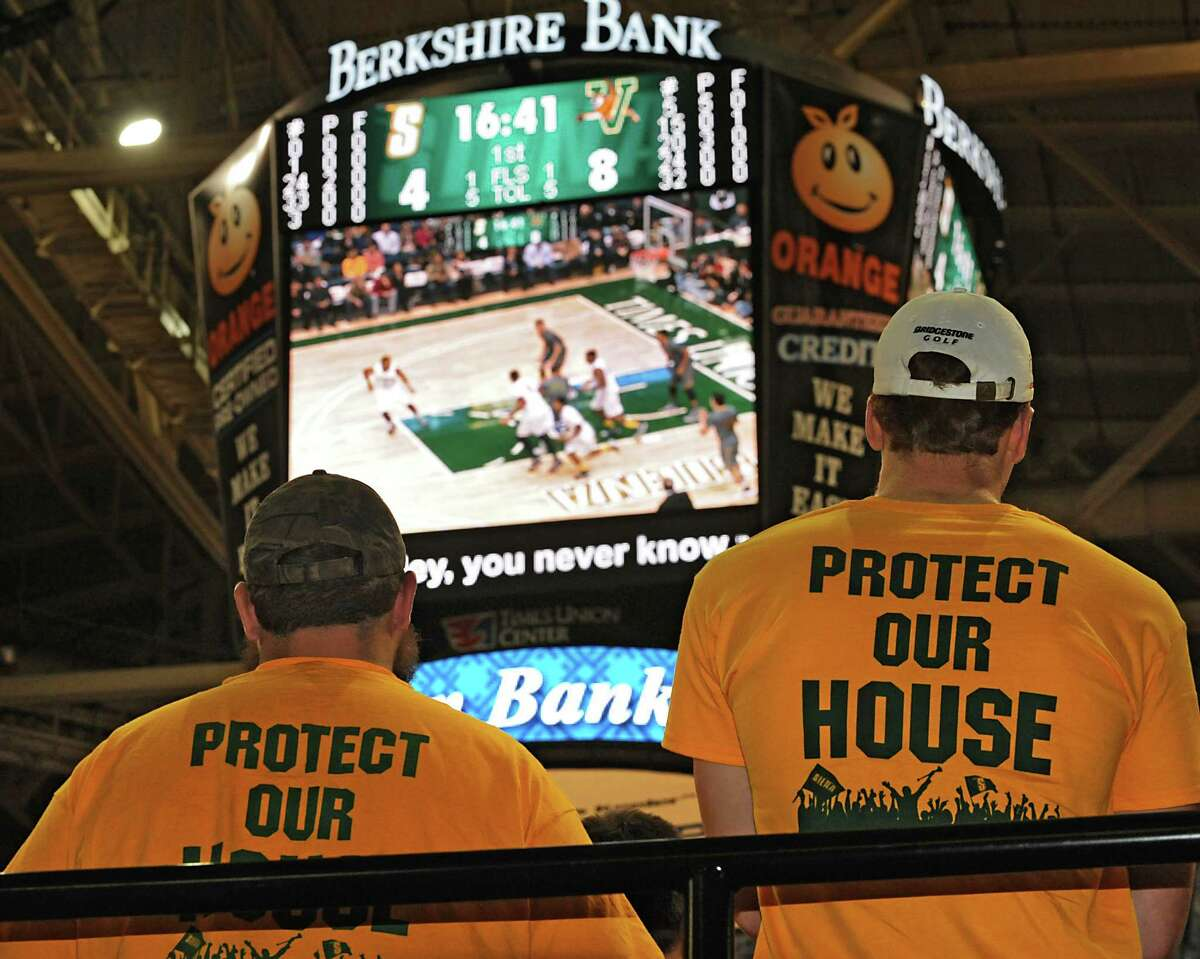 Siena fans watch their team during a basketball game against Vermont at the Times Union Center on Monday, Nov. 17, 2014 in Albany, N.Y. (Lori Van Buren / Times Union)