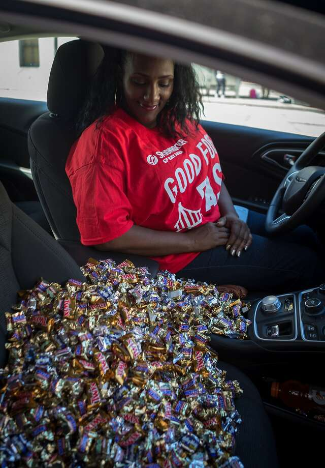 Danetta Davies of SpoonRocket delivers an order of candy to The San Francisco Chronicle's office on Monday, Oct. 26, 2015 in San Francisco, Calif.  SpoonRocket which normally delivers ready-made meals in under 15 minutes is offering a special halloween candy service this week only. Photo: Nathaniel Y. Downes, The Chronicle