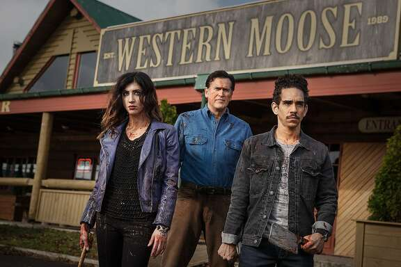 """Bruce Campbell, center, is Ash Carter, Ray Santiago is Pablo Simon Bolivar and Dana DeLorenzo is Kelly Maxwell is """"Ash vs. Evil Dead"""""""