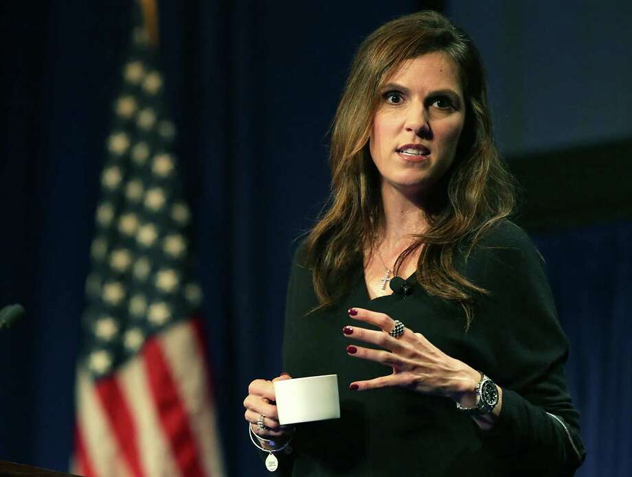 Taya Kyle, the wife of the late Navy SEAL marksman Chris Kyle, focused on family and patriotism in the keynote address Monday for the DUG Eagle Ford Conference. Photo: Bob Owen /San Antonio Express-News / San Antonio Express-News