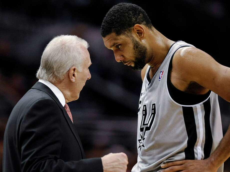 San Antonio Spurs coach Gregg Popovich, left, talks to forward Tim Duncan during the second half of an NBA basketball game against the Oklahoma City Thunder, Saturday, Dec. 21, 2013, in San Antonio. Oklahoma City won 113-100. (AP Photo/Darren Abate) ORG XMIT: TXDA110 Photo: Darren Abate / FR115 AP