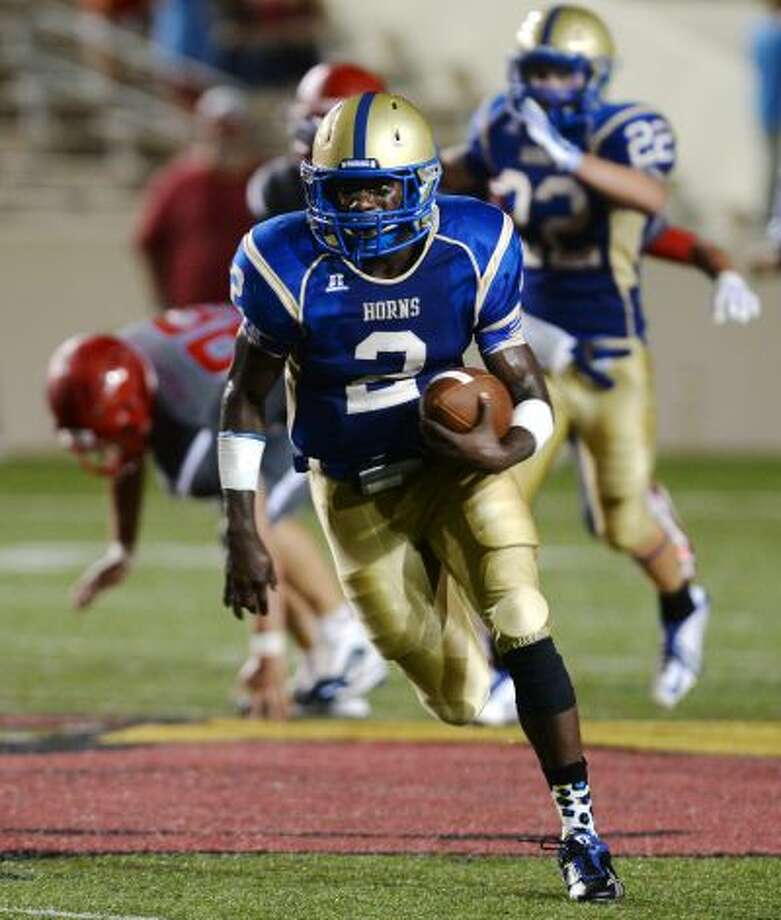 Hamshire-Fannett's Kendrick King verbally committed to play football at Lamar University over the weekend. King has rushed for 1,246 yards and 22 touchdowns on 151 carries this season. Hamshire-Fannett's Kendrick King, No. 2, breaks away and heads in for a touchdown during Thursday's game against Lumberton. The Hamshire-Fannett Longhorns opened their season Thursday night against the Lumberton Raiders at Provost Umphrey Stadium. Photo taken Thursday 8/28/14 Jake Daniels/@JakeD_in_SETX Photo: Jake Daniels   ####### Photo: Photo: Jake Daniels