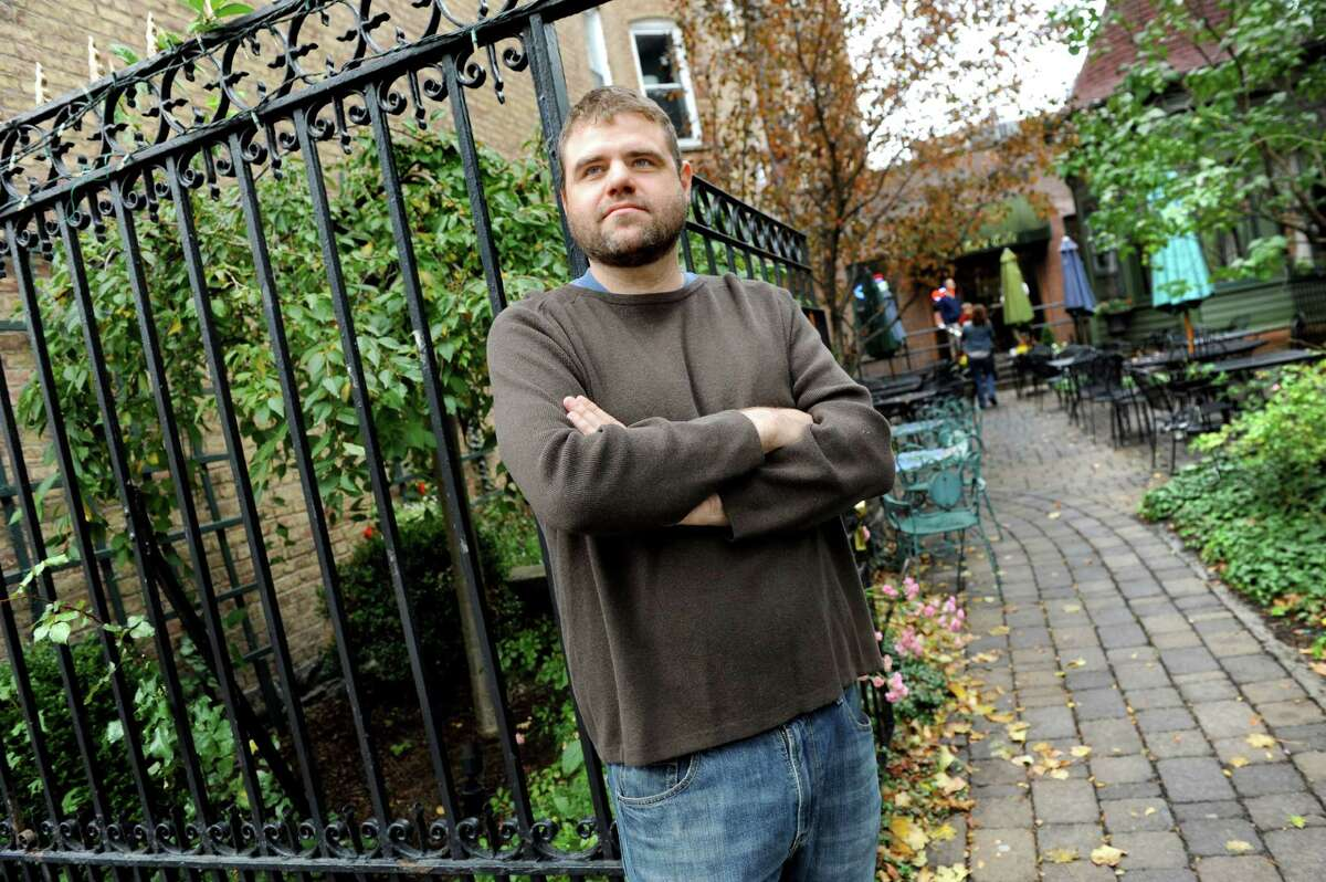 Owner Kevin Dively outside the cafe's courtyard along Washington Avenue on Wednesday, Oct. 21, 2015, at the Iron Gate Cafe in Albany, N.Y. (Cindy Schultz / Times Union)