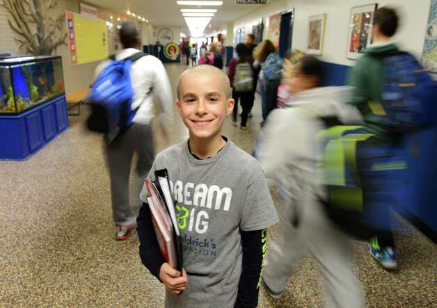 Jeremy Wernick, a 7th grader at Shaker Junior High School, stands in the school's hallway Monday  Oct. 26, 2015, in Colonie, N.Y. Since third grade, Wernick has shaved his head bald each fall to support the St. Baldrick?s campaign. He's raised $8,600 so far. He also collects hats for a program at Albany Med that provides them to kids who lose their hair due to cancer treatments. (Will Waldron/Times Union) Photo: Will Waldron / 00033940A