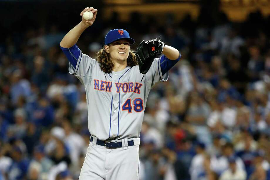 LOS ANGELES, CA - OCTOBER 15:  Jacob deGrom #48 of the New York Mets reacts while on the mound in the fifth inning while taking on the Los Angeles Dodgers in game five of the National League Division Series at Dodger Stadium on October 15, 2015 in Los Angeles, California.  (Photo by Sean M. Haffey/Getty Images) Photo: Sean M. Haffey, Staff / Getty Images / 2015 Getty Images