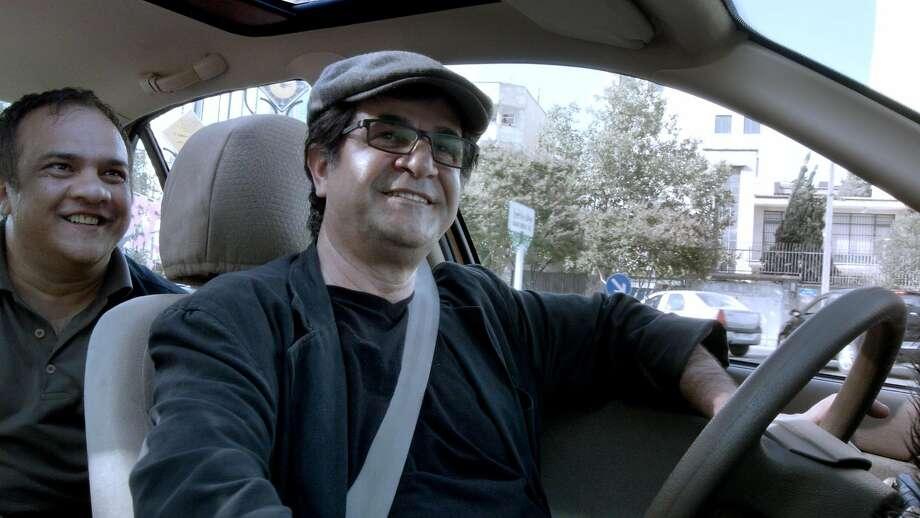 """Iranian director Jafar Panahi (right) casts himself as a cabbie in the comically subversive """"Jafar PanahiÕs Taxi.""""  Credit: Kino Lorber Photo: Kino Lorber"""