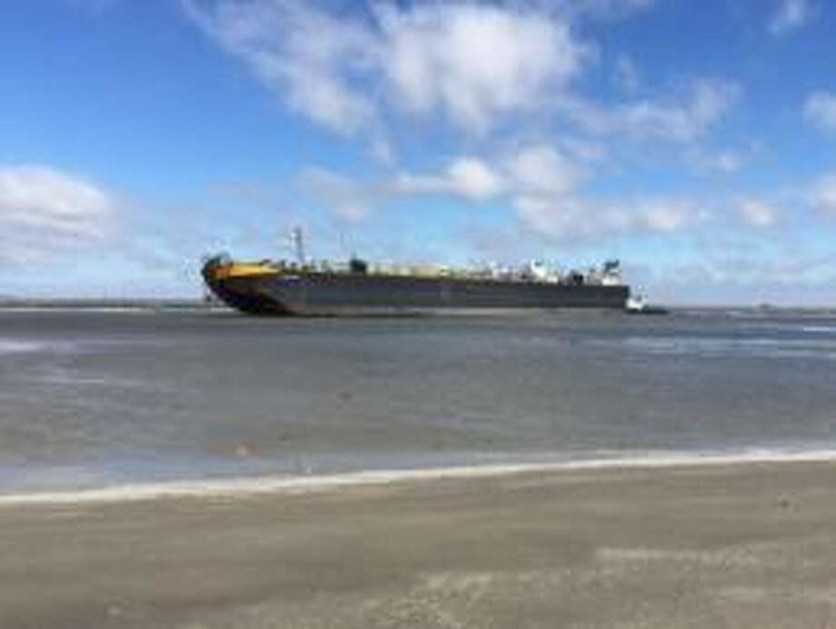 The tug boat named the Peter F. Gellatly has been grounded off Galveston's East Beach since Sunday. Photo: Coast Guard