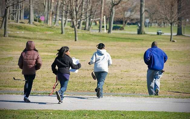 "A team of Stamford middle school students run to safety as they participate in the ""Rites of Passage"" scavenger hunt/survivor event at Cove Island Park in Stamford, Conn. on Saturday, March 27, 2010.  The students use information they've learned over the past 14 weeks to help in their clue searching and survival at the event. Photo: Kathleen O'Rourke / Stamford Advocate"