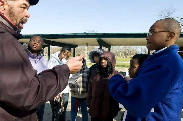 "Program coordinator Rodney Bass instructs Stamford middle school students on details and objectives as they participate in the ""Rites of Passage"" scavenger hunt event at Cove Island Park  in Stamford, Conn. on Saturday, March 27, 2010.   The Rites of Passage Program is designed to assist primarily, but not exclusively, African-American students in accurately learning about and integrating the significance of their African and American heritages. Photo: Kathleen O'Rourke / Stamford Advocate"