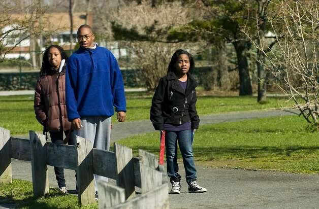 "Tasia Aime, 11, Kenny Wright, 14, and Megan Pierre, 12, watch for the ""slave catchers"" as they participate in the ""Rites of Passage"" scavenger hunt event at Cove Island Park in Stamford, Conn. on Saturday, March 27, 2010. Photo: Kathleen O'Rourke / Stamford Advocate"