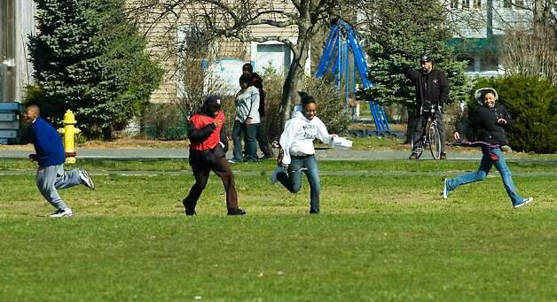"Stamford middle school students run from the ""slave catchers"" as they participate in the ""Rites of Passage"" scavenger hunt event at Cove Island Park  in Stamford, Conn. on Saturday, March 27, 2010.   The Rites of Passage Program is a district-supported program, designed to assist primarily, but not exclusively, African-American students in accurately learning about and integrating the significance of their African and American heritages. Photo: Kathleen O'Rourke / Stamford Advocate"