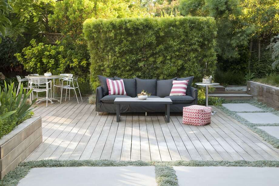 Alice and Dennis Oliver of San Mateo replaced their backyard lawn with a large deck and spaces for easy entertaining. Photo: Caitlin Atkinson