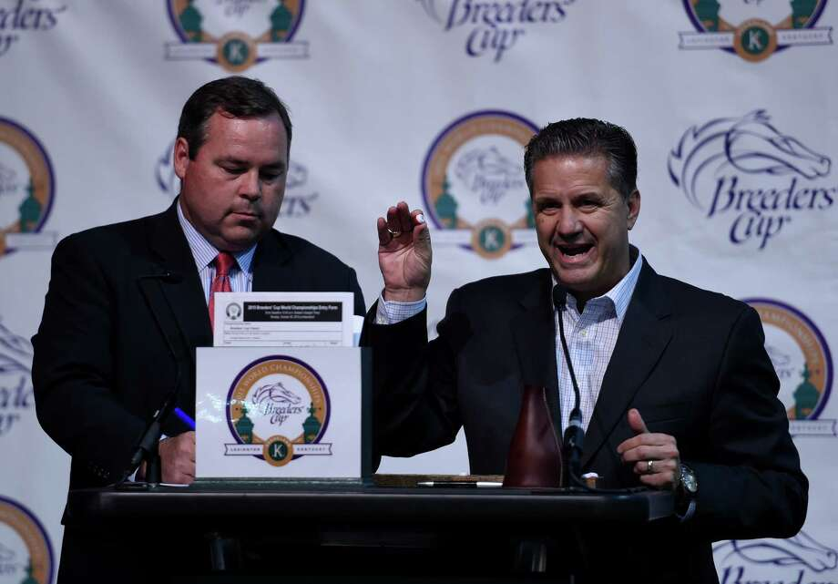 University of Kentucky Men's Basketball coach John Calipari, right assists Keeneland Racing Secretary Ben Hoffman Monday evening Oct. 26, 2015, with the post position draw for the Breeders' Cup Classic that will run on Saturday at the Keeneland Race Course in Lexington, KY    (Skip Dickstein/Times Union) Photo: SKIP DICKSTEIN