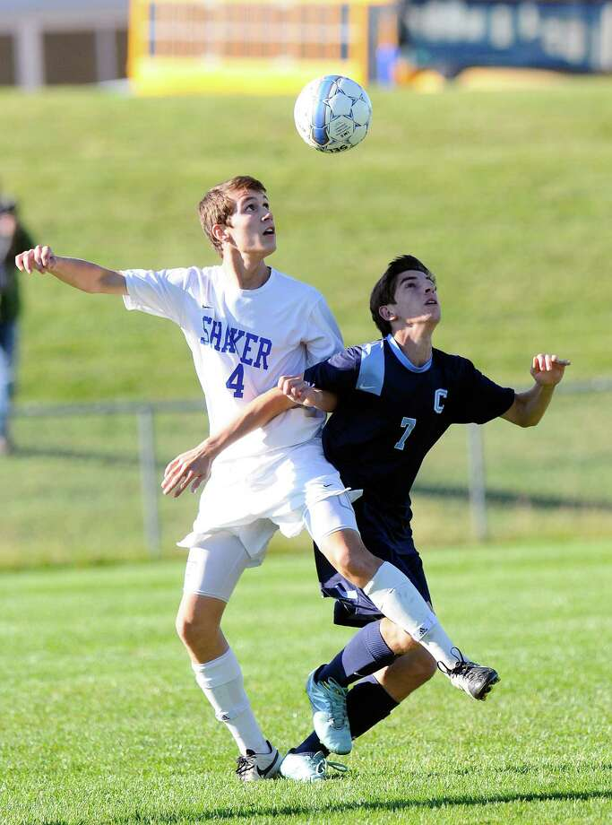 Shaker's Brent Durante (4) and Columbia's Braden Howe (7) battle for the ball during a Section II Class AA boys' high school soccer quarterfinal game in Latham, N.Y., Monday, Sept. 26, 2015. (Hans Pennink / Special to the Times Union) ORG XMIT: HP101 Photo: Hans Pennink / 00033932A