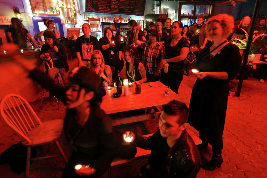 Family and friends attend a memorial, at La Botanica Monday Oct. 26, 2015, for musician Shawn Terry, a fixture on the St. Mary's Strip with such bands as the Mechanical Walking Robotboy and Guilty Strangers. Terry died on Saturday from complications of cancer after being diagnosed in the fall.