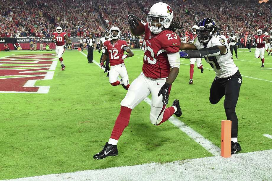 GLENDALE, AZ - OCTOBER 26:  Running back Chris Johnson #23 of the Arizona Cardinals runs in a 26 yard touchdown against linebacker C.J. Mosley #57 of the Baltimore Ravens in the first quarter of the NFL game at University of Phoenix Stadium on October 26, 2015 in Glendale, Arizona.  (Photo by Norm Hall/Getty Images) ORG XMIT: 570168831 Photo: Norm Hall / 2015 Getty Images