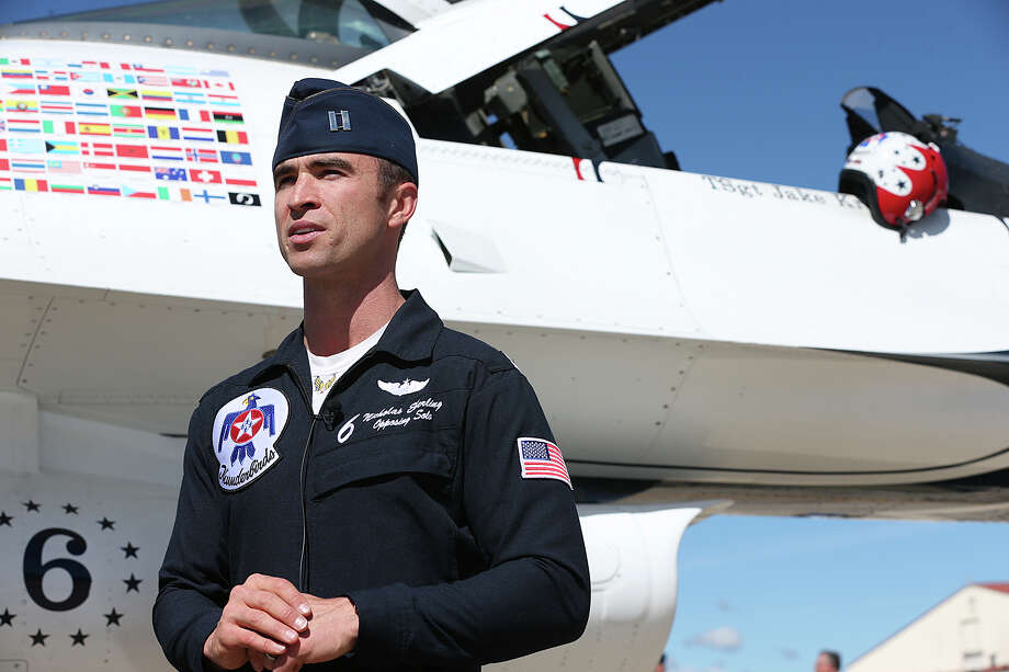 United States Air Force Thunderbirds Captain Nicholas Eberling, of Ashburn, VA., talks with media upon the team's arrival at Randolph Air Force Base on Monday, Oct. 26, 2015. They are scheduled to perform at the Joint Base San Antonio Air Show and Open House at Randolph this Saturday and Sunday. According to Eberling, the Thunderbirds will put on a show that will amaze the public during the two-day event. Photo: JERRY LARA, Staff / San Antonio Express-News / © 2015 San Antonio Express-News