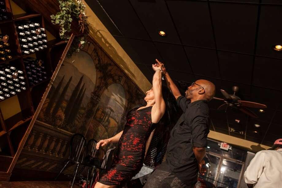 Gordon Scott Williams and Magda Villarreal dance at D'Vine Wine's salsa night. Photo: Cat5