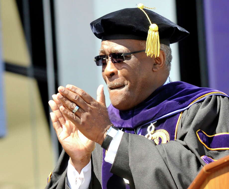 University at Albany Presidne Robert J. Jones applauds graduates during the undergraduate commencement exercises in Albany, N.Y., Sunday, May 18, 2014. (Hans Pennink / Special to the Times Union) ORG XMIT: HP113 Photo: Hans Pennink / Hans Pennink