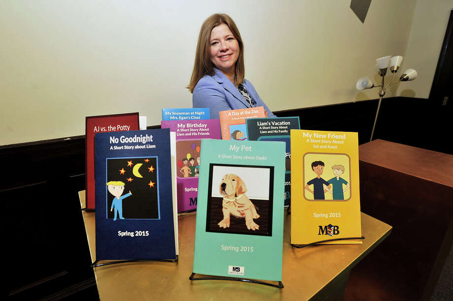 Mirror Books founder Theresa Robbins in June 2015, with the customized books her startup produces for children. Photo: Jason Rearick / Hearst Connecticut Media / Stamford Advocate
