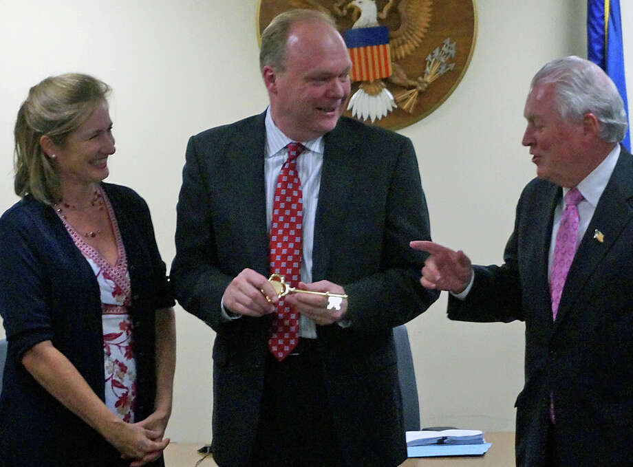 Selectman Kevin Kiley, center, who took part in his last Board of Selectmen meeting Wednesday, was honored by Selectman Sheila Marmion and First Selectman Mike Tetreau. Photo: Genevieve Reilly / Fairfield Citizen / Fairfield Citizen