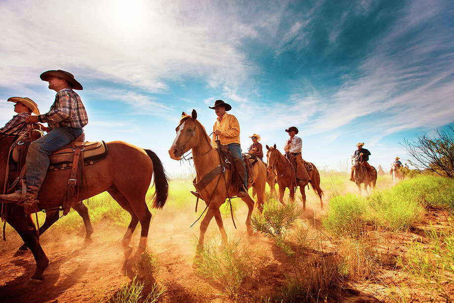 Cowboys ride out into a pasture to round up cattle on Waggoner Ranch. Photo: Jeremy Enlow / jeremyenlow.com
