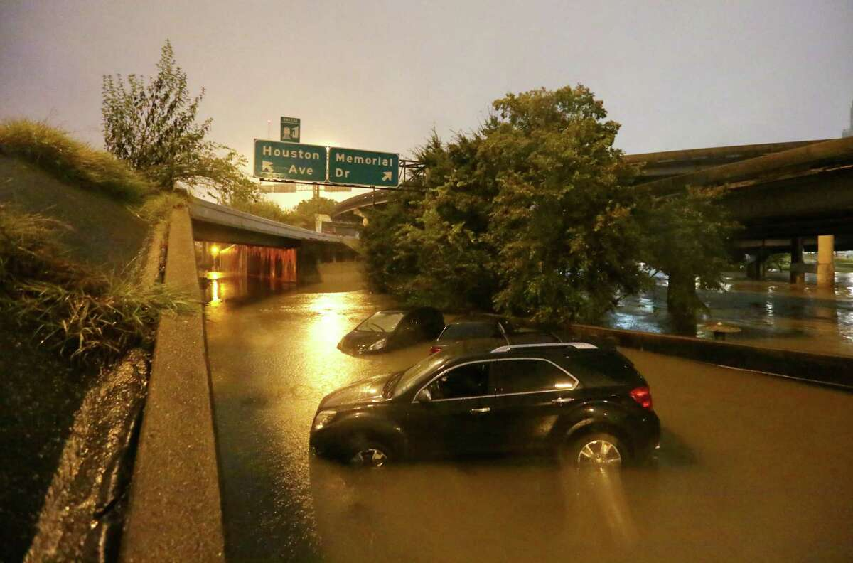 Four cars sit in water at the Houston Avenue and Memorial Drive exit on IH-45 Sunday, Oct. 25, 2015, in Houston. Buffalo Bayou spilled into the underpass as heavy rains moved into the area over night dropping four to nine inches of rain across parts of Harris County.