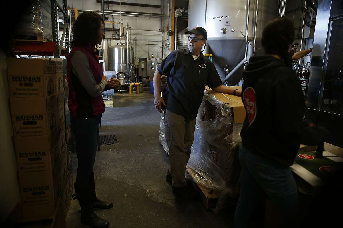 Co-owners Natalie (left) and Vinnie Cilurzo (middle) talk in their production plant at Russian River Brewing Company in Santa Rosa, Calif., on Monday, October 26, 2015.