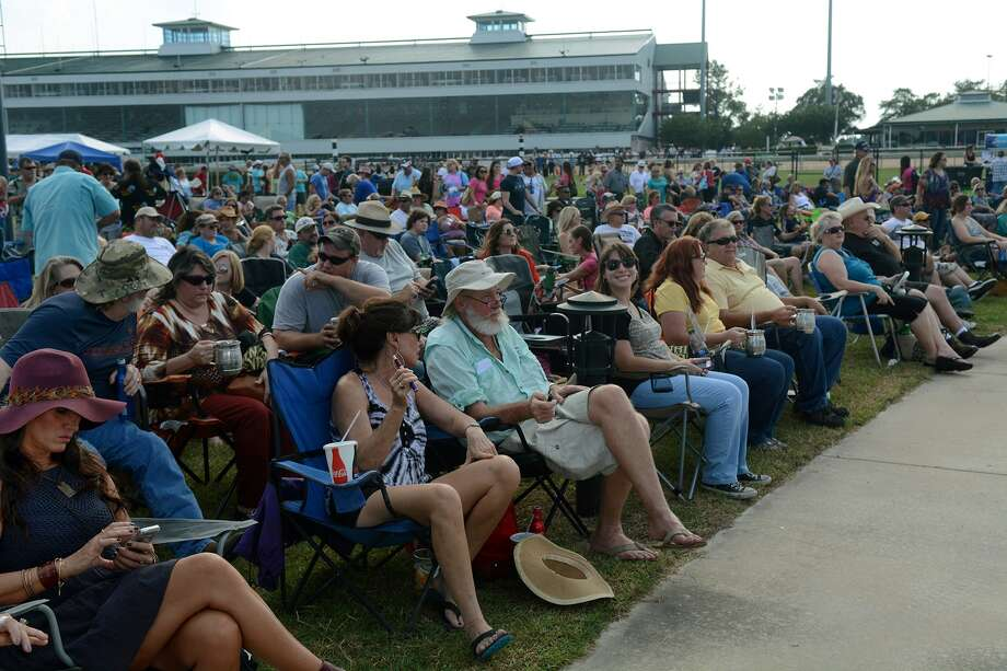 Concert-goers, including Marshall and Clint Clark, center, of Cypress, take in the sights and sounds during the Coastal Conservation Association Texas Concert at Sam Houston Race Park on Sept. 27.Concert-goers, including Marshall and Clint Clark, center, of Cypress, take in the sights and sounds during the Coastal Conservation Association Texas Concert at Sam Houston Race Park on Sept. 27. Photo: Jerry Baker, Freelance