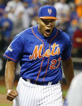 New York Mets relief pitcher Jeurys Familia reacts after Los Angeles Dodgers' Andre Ethier grounded out to him during the ninth inning of the Mets' 13-7 victory over the Dodgers in baseball's Game 3 of the National League Division Series, Tuesday, Oct. 13, 2015, in New York. (AP Photo/Kathy Willens)