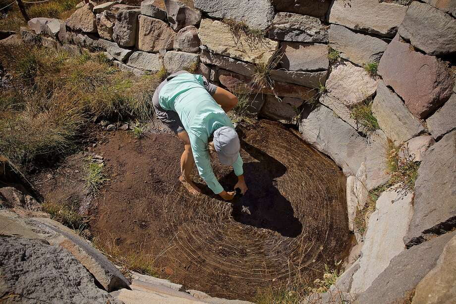Left: Lawrence Livermore National Laboratory research scientist Brad Esser, left, and Professor Jean Moran record data. Right: Moran collects a water sample. The research team is hoping to estimate the age of the water, so they can understand the effects of the drought and climate change on water resource in that region. Photo: Garvin Tso