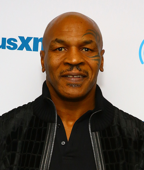 Mike Tyson takes a spill on a hoverboard (w/video ...