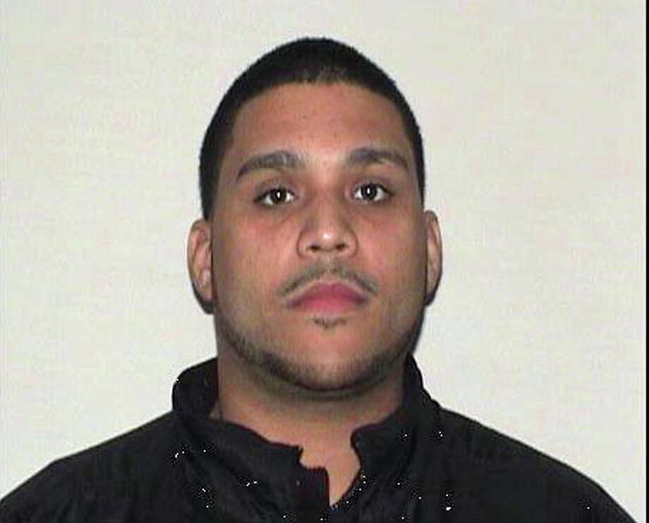 Elliot Perez, a truck driver, was charged by Stratford, Conn. police with 111 counts of theft of a firearm and 111 counts of criminal possession of a firearm after police said he stole 111 handguns from a Smith & Wesson plant in Springfield, Mass and transported them to Bridgeport, Conn. to sell on the street in Nov. 2012. On Tuesday, Oct. 27, 2015. Perez was senetnced to 210 months of imprisonment, followed by three years of supervised release Photo: Contributed Photo / Contributed Photo / Connecticut Post