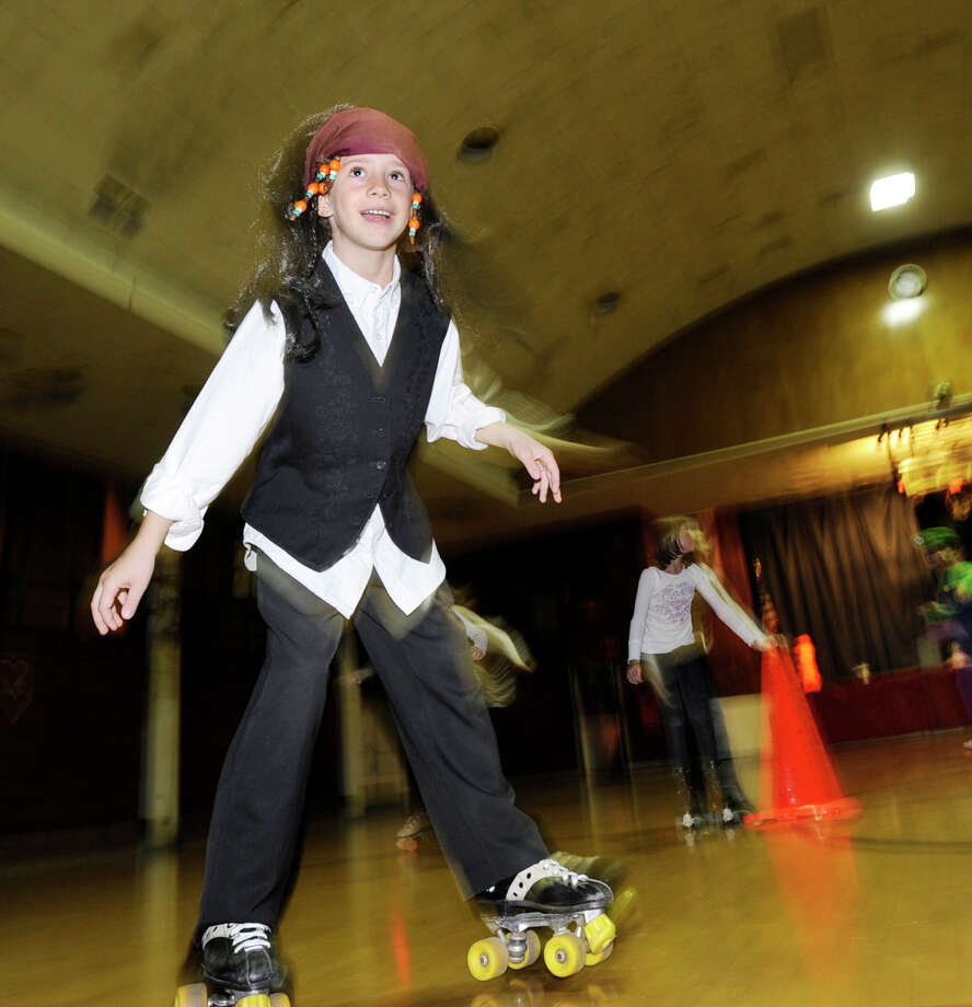 Caleb Fockens, 8, of Old Greenwich, wears a pirate custome during the Friday Night Halloween Skate at the Old Greenwich Civic Center, Oct. 28, 2011. Photo: Bob Luckey / Bob Luckey / Greenwich Time