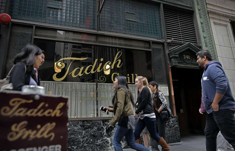 People passing by the Tadich Grill on California St. in San Francisco Tues. October 27, 2015. Photo: Michael Macor, The Chronicle
