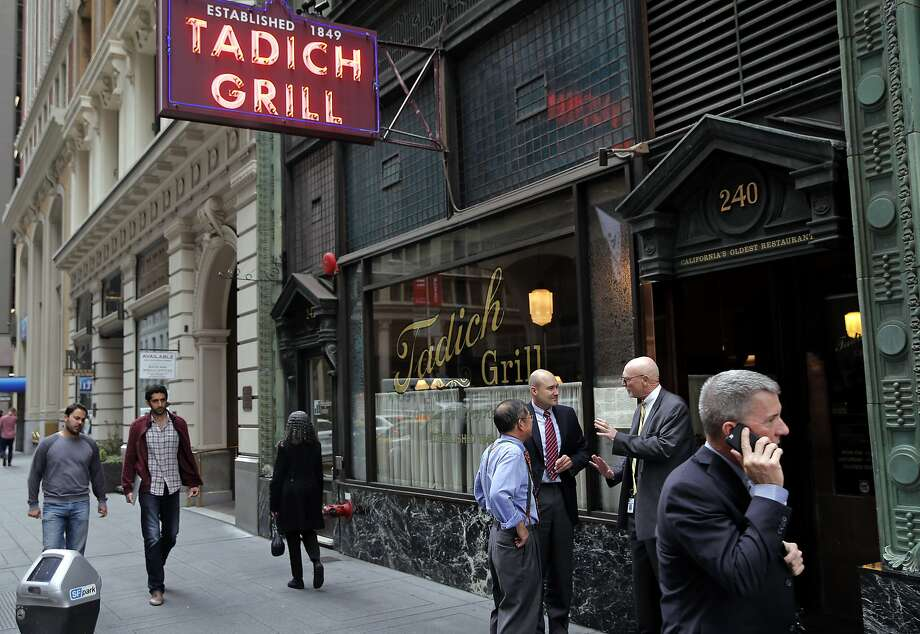 People pass by the Tadich Grill on California Street in San Francisco on Oct. 27. Photo: Michael Macor, The Chronicle