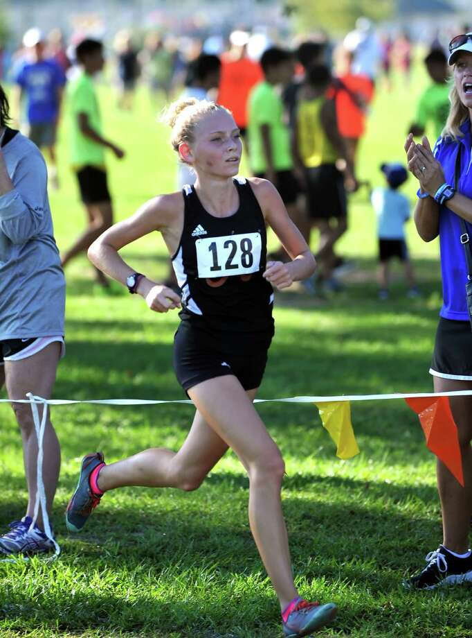 Spring Branch Cross Country Meet, 9-19-2015, held at Nottingham Park.  Kaytlynn Welsch, sophomore at Alvin, crossed the finish line and placed third in the varsity girls race. Photo: Eddy Matchette, Freelance / Freelance