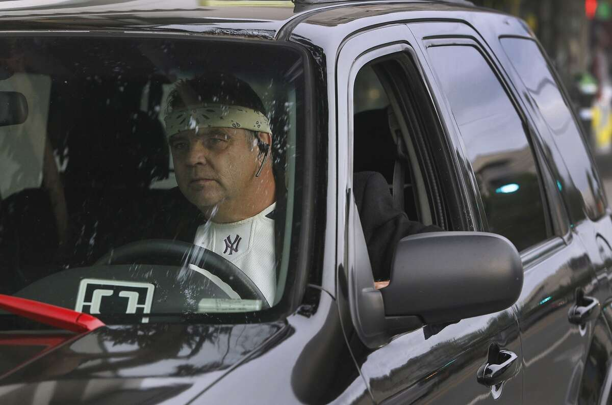 John Sollars drives through the Mission District waiting to pick up passengers requesting the UberX ride service in San Francisco, Calif. on Tuesday, Oct. 27, 2015. Sollars generally avoids areas designated by Uber for surge pricing and concentrates more on his own strategy.
