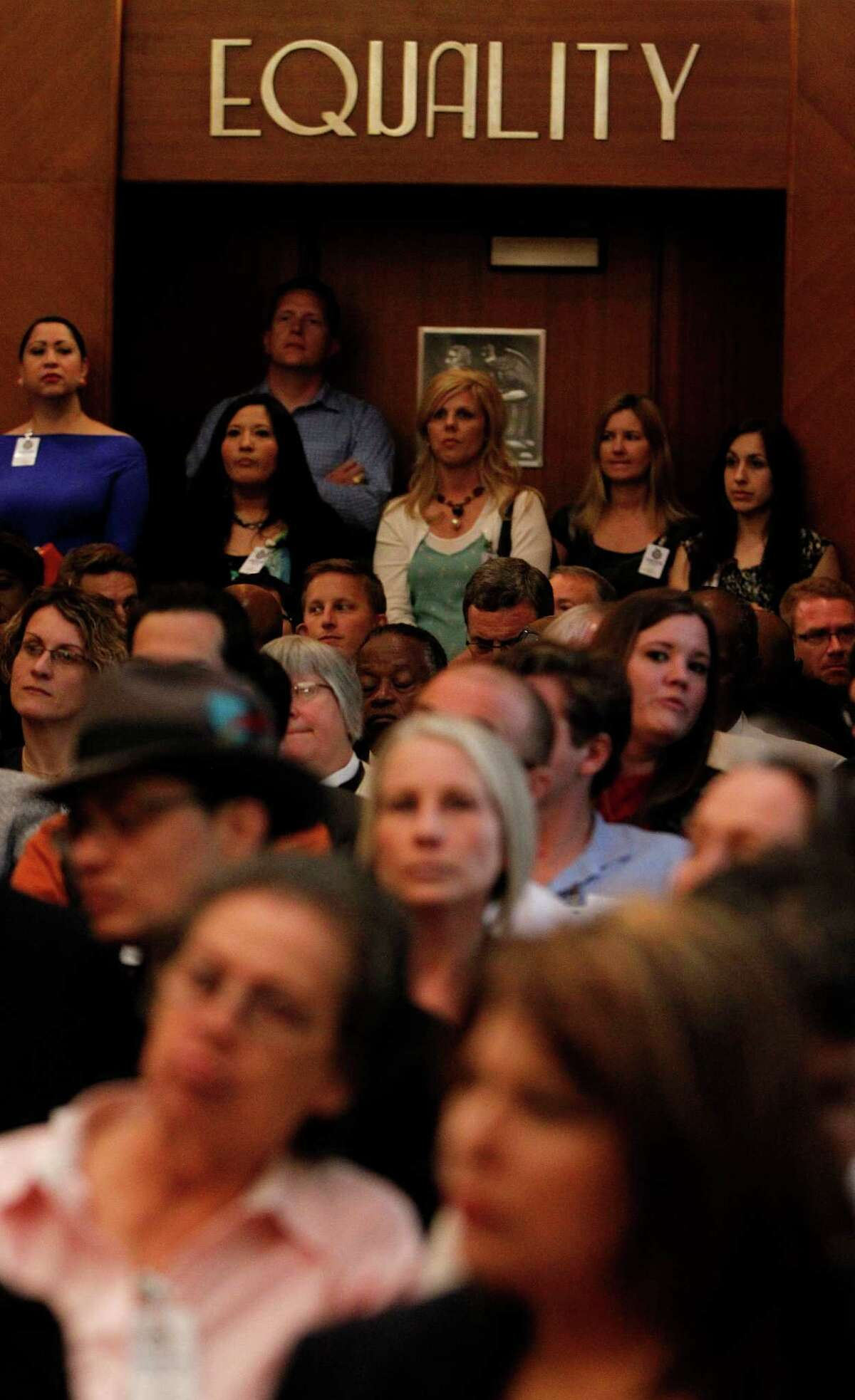 A crowd listens during a 2014 City Hall discussion on the Houston Equal Rights Ordinance.