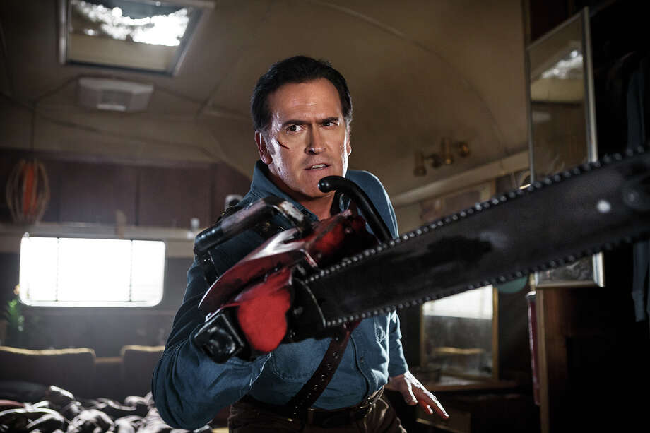 Dim but determined demon-fighter Ash (Bruce Campbell) wields his deadly chainsaw in 'Ash vs. Evil Dead' on Starz. October, 2015 Photo: Starz / Starz / © 2015 Starz Entertainment, LLC