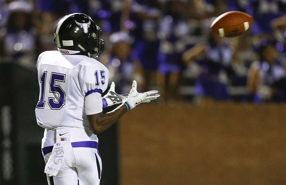 Aaron Solomon of Morton Ranch makes a touchdown catch as the Mavericks took on Katy Tompkins  in 19-6A District play at Rhodes Stadium in Katy on October 23, 2015. Photo: Diana L. Porter, Freelance / © Diana L. Porter