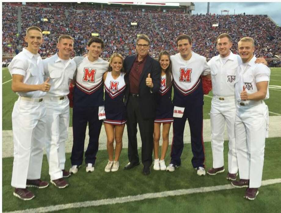 Rick Perry poses with Ole Miss and Texas A&M supporters at Kyle Field. Photo: White, Tyler L, Instagram